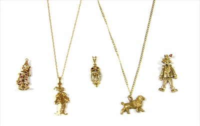 Lot 31-A 9ct gold articulated jester charm