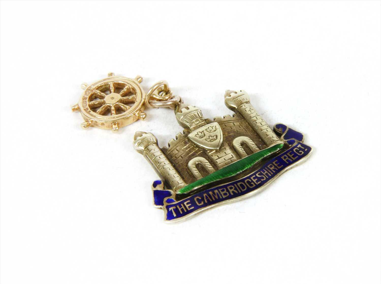 Lot 13-A white gold enamel Cambridgeshire Regiment military sweetheart pendant