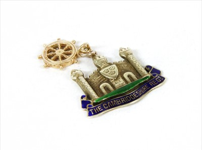 Lot 13-A white gold enamel Cambridgeshire Regiment military sweetheart pendant