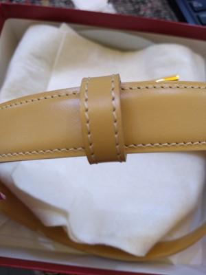 Lot 247 - A Cartier beige leather 'Love' belt