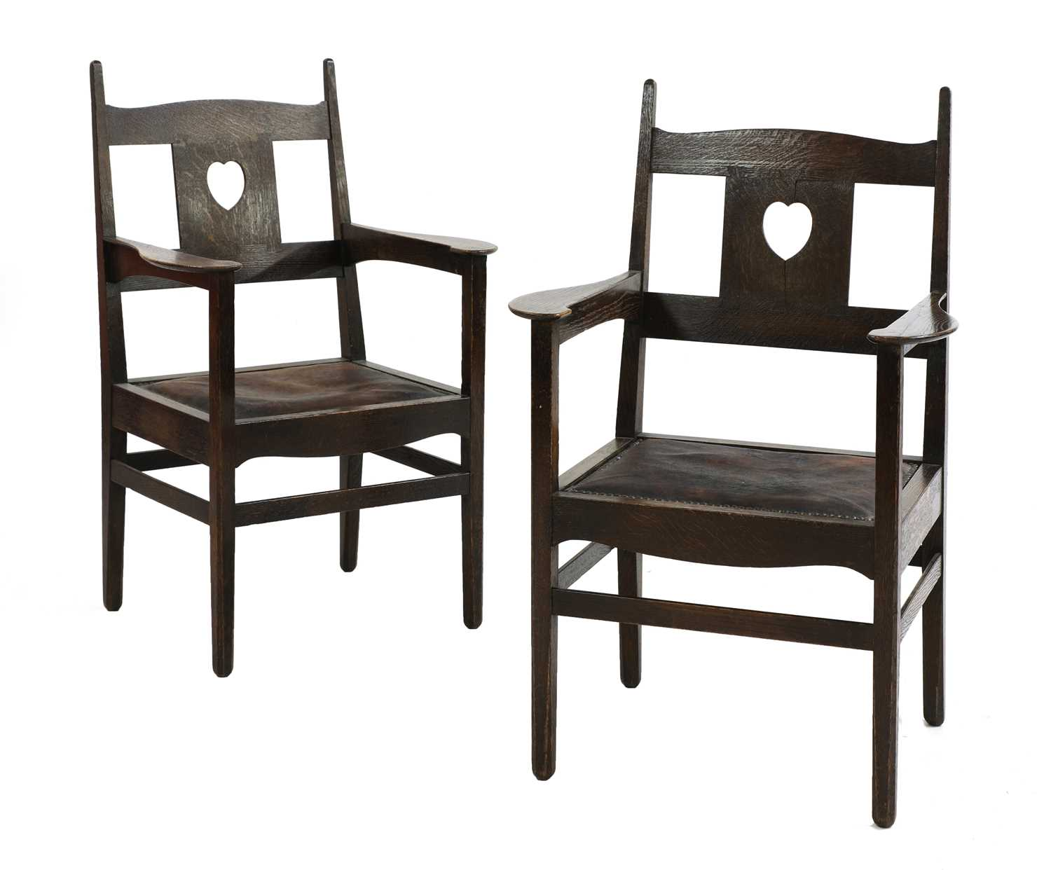 224 - A pair of rare Arts and Crafts oak armchairs,