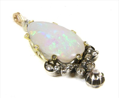Lot 9-A gold and silver, opal and diamond pendant