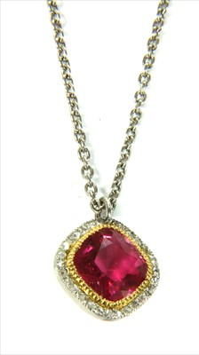 Lot 19-A platinum pink tourmaline and diamond halo cluster pendant