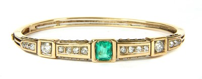 Lot 8-A late Victorian emerald and diamond hinged bangle, c.1880