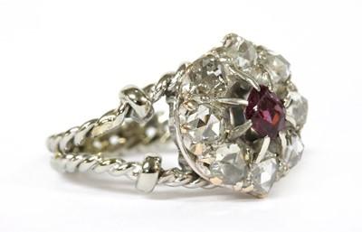 Lot 17-An Edwardian garnet and diamond cluster