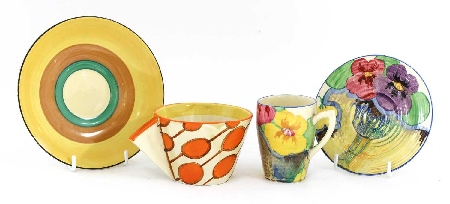Lot 373 - A Clarice Cliff 'Umbrellas and Rain' pattern teacup and saucer