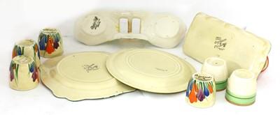Lot 370 - A Clarice Cliff 'Crocus' pattern egg cup set