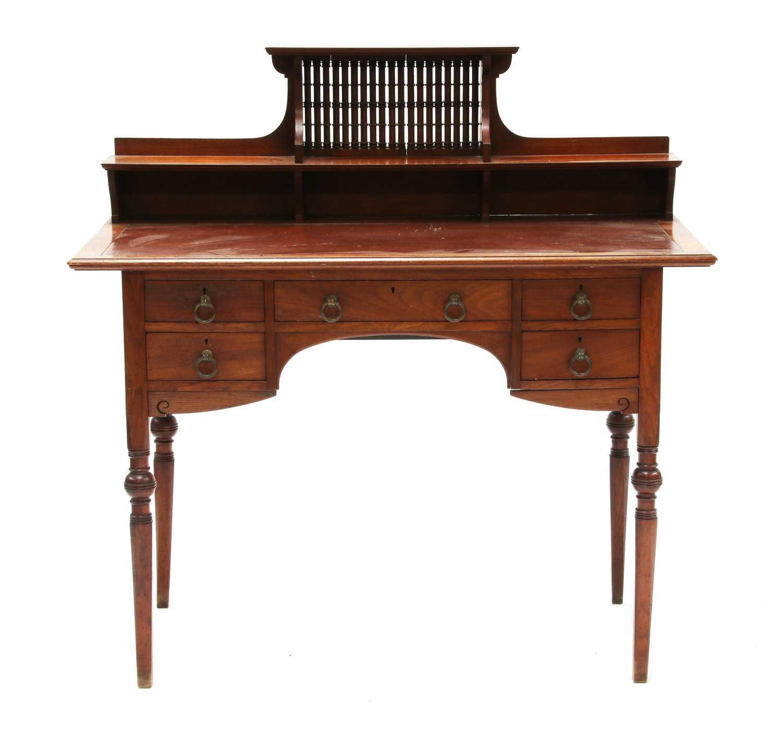 Lot 47 - A Liberty & Co. walnut desk