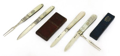 Lot 26-Four silver and mother-of-pearl folding fruit knives and forks