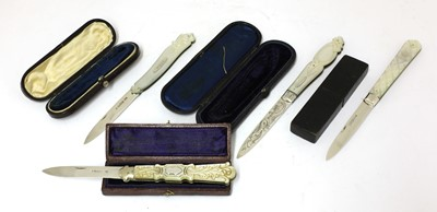 Lot 49-Four Victorian carved mother-of-pearl and silver folding fruit knives