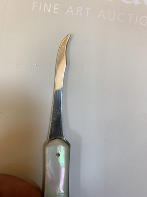 Lot 23-Three silver and mother-of-pearl combination folding fruit knives