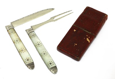 Lot 20-A Georgian silver and mother-of-pearl folding fruit knife and fork