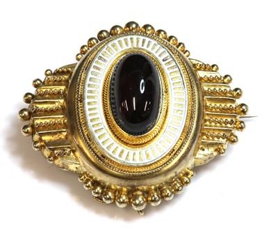Lot 4-A Victorian Etruscan Revival gold garnet and enamel shield form brooch, c.1860