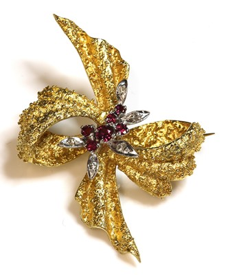 Lot 48-An 18ct gold two colour ruby and diamond bow brooch, c.1950