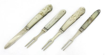 Lot 25-Three silver and mother-of-pearl folding fruit forks and a knife