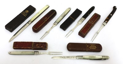 Lot 29-Six silver-mounted folding fruit knives and forks in cases