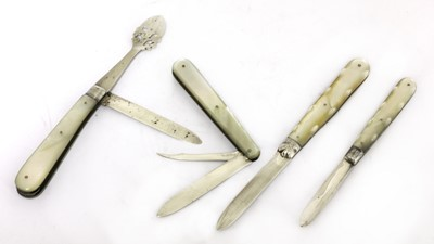 Lot 28-Four silver and mother-of-pearl folding fruit knives