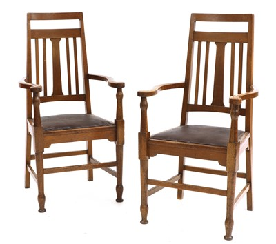 Lot 139 - A pair of Arts and Crafts oak elbow chairs