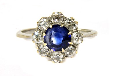 Lot 20-A white gold sapphire and diamond circular cluster ring