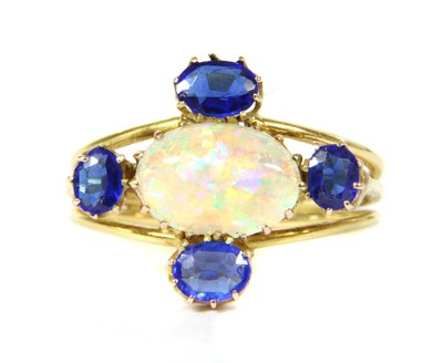 Lot 24-An Edwardian gold opal and garnet topped doublet cinquefoil cluster ring