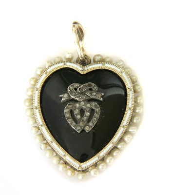 Lot 10-A Victorian gold onyx, diamond, enamel and seed pearl heart pendant
