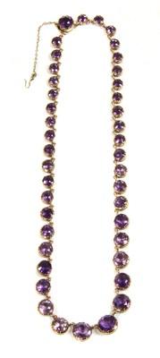 Lot 11-A Victorian gold amethyst graduated rivière necklace, c.1880