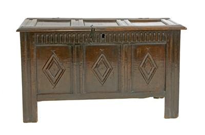 Lot 99 - An oak triple-panelled coffer