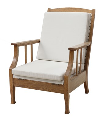 Lot 142 - A Swedish Arts and Crafts oak lounger chair