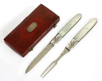 Lot 21-A mother-of-pearl and silver folding fruit knife and fork set