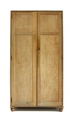 Lot 429 - An Heal's limed oak wardrobe