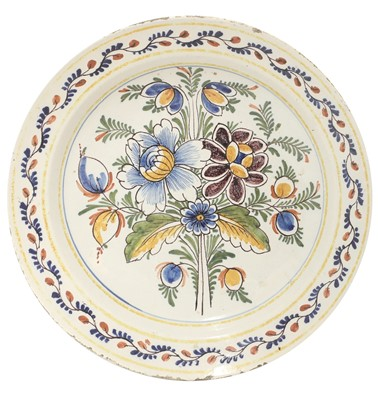 Lot 85 - A French faience charger