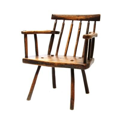 Lot 91 - A primitive fruitwood stick back armchair