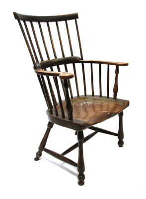 Lot 92 - An ash and elm comb back Windsor armchair