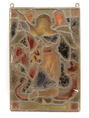 Lot 33 - A stained glass panel of an angel lancing a dragon
