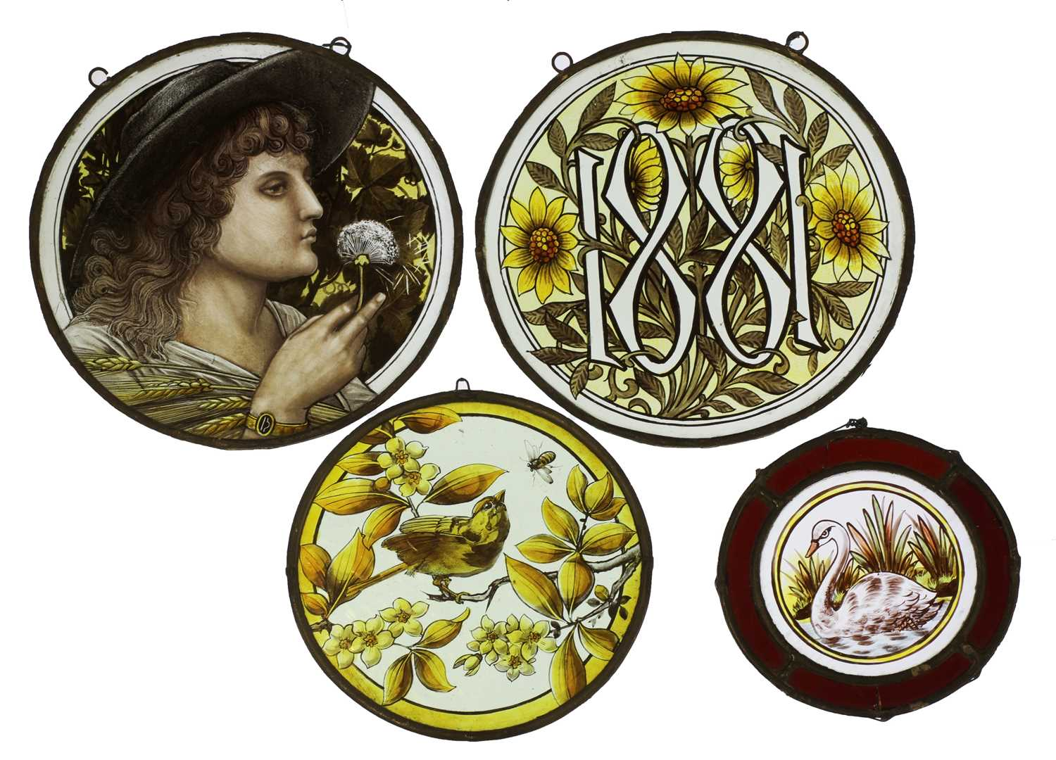 Lot 32-Four stained glass roundels