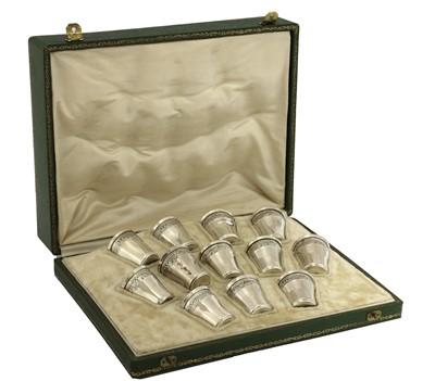 Lot 76 - A cased set of twelve French 950 standard silver vodka or liqueur cups