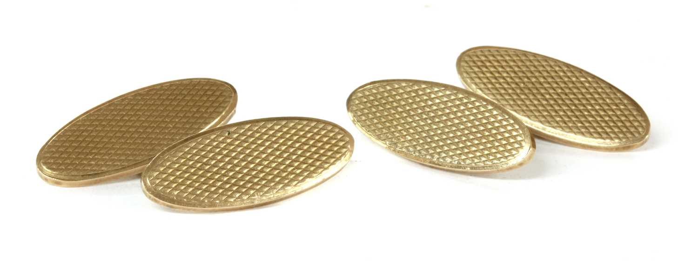 Lot 24-A pair of Art Deco 9ct gold cufflinks