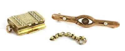 Lot 29-A gold rectangular locket