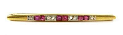 Lot 35-An Art Deco, gold, ruby and diamond bar brooch