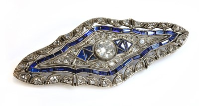 Lot 132 - An Art Deco Continental white gold diamond and synthetic sapphire plaque brooch, c.1925
