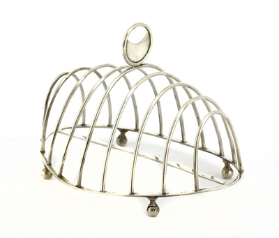 Lot 16-A George III silver oval eight-division toast rack