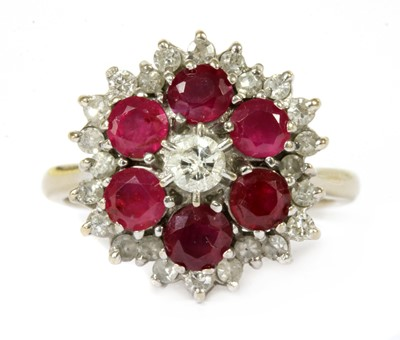 Lot 44-A white gold diamond and ruby target cluster ring