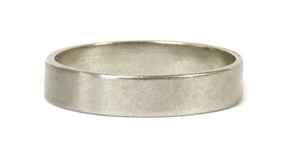 Lot 33-A platinum flat section wedding ring