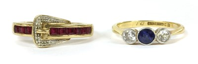 Lot 36-A gold sapphire and diamond three stone ring