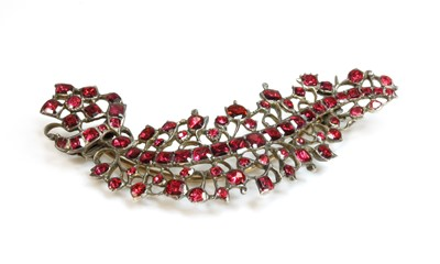 Lot 12 - A foil-backed flat cut garnet brooch