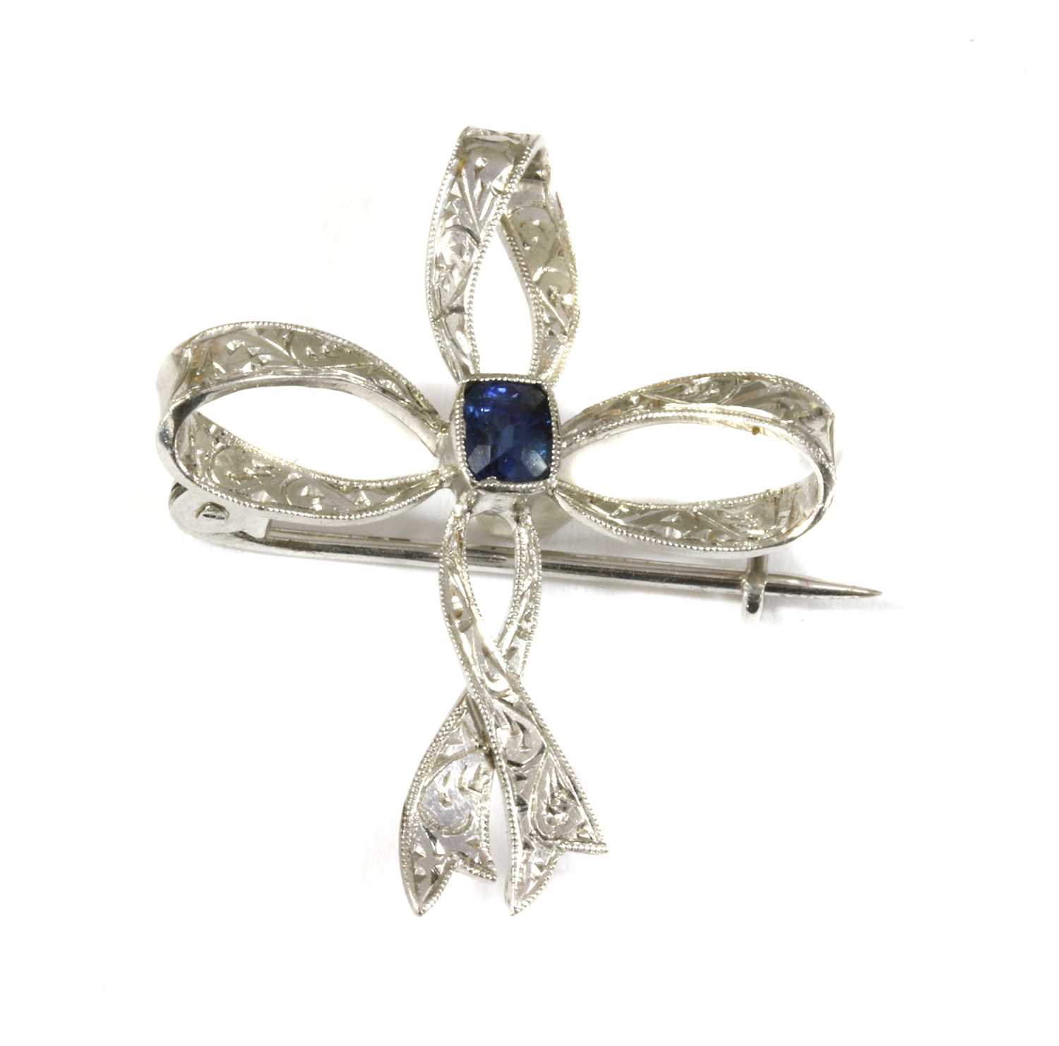 Lot 18-An Edwardian white gold sapphire bow brooch