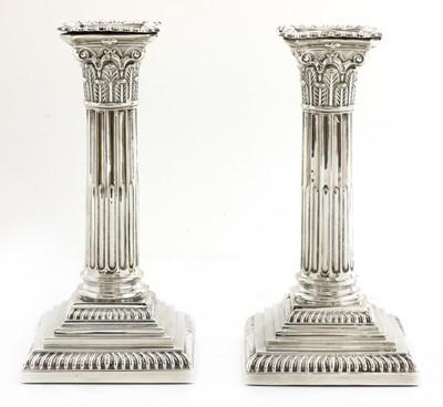 Lot 25-A pair of Victorian silver Corinthian column candlesticks