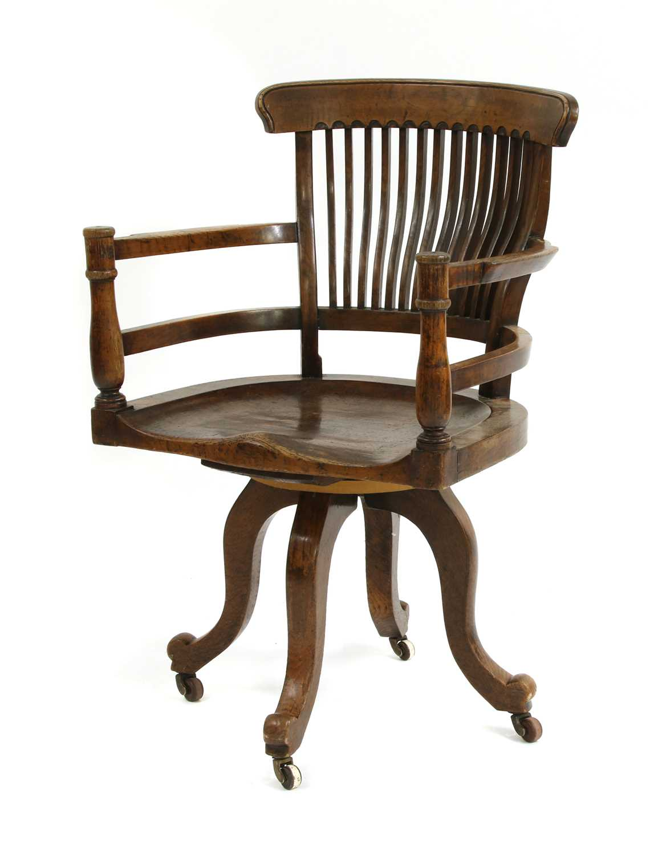 Lot 10-A revolving desk chair