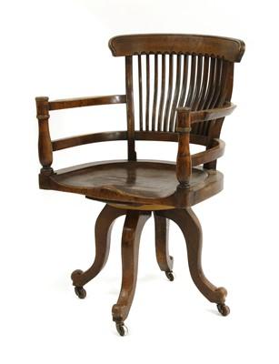 Lot 10 - A revolving desk chair