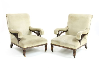 Lot 71 - A pair of walnut armchairs